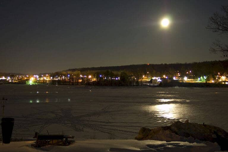 Moon light above a frozen bay
