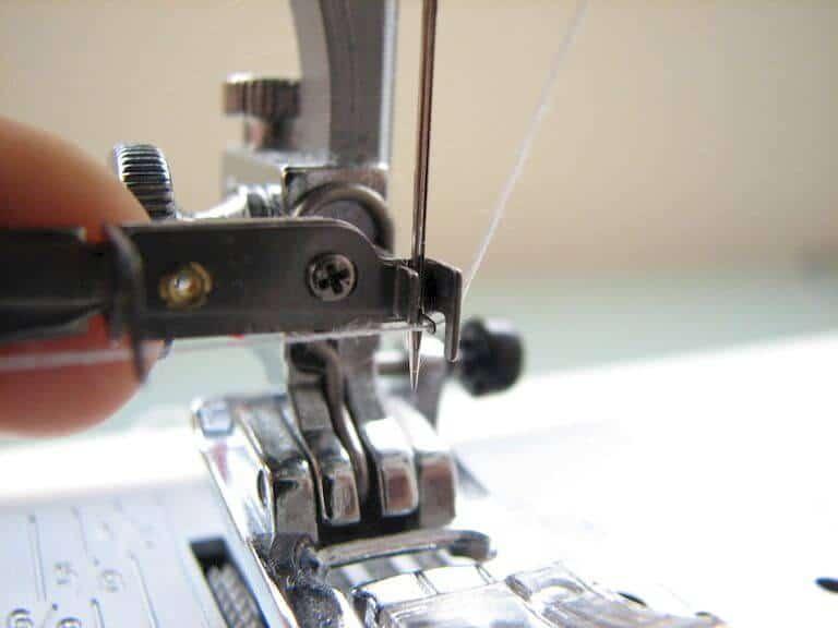 Placing thread across hooks